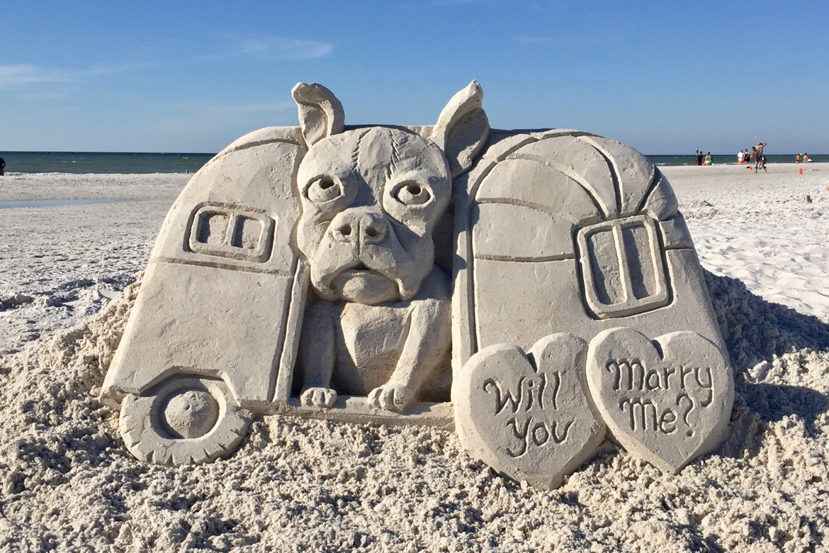 Custom sand sculptures for marriage proposal on the beach, Florida, USA