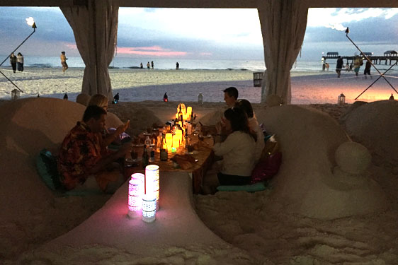 Dining in the sand with lanterns