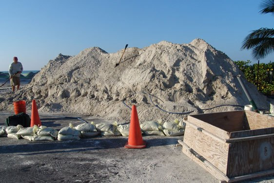Sand sculpting and carving process begins